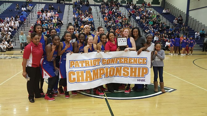 The T.C. Williams girls' basketball team defeated West Springfield 69-66 in double overtime on Feb. 21 to win the Conference 7 championship.