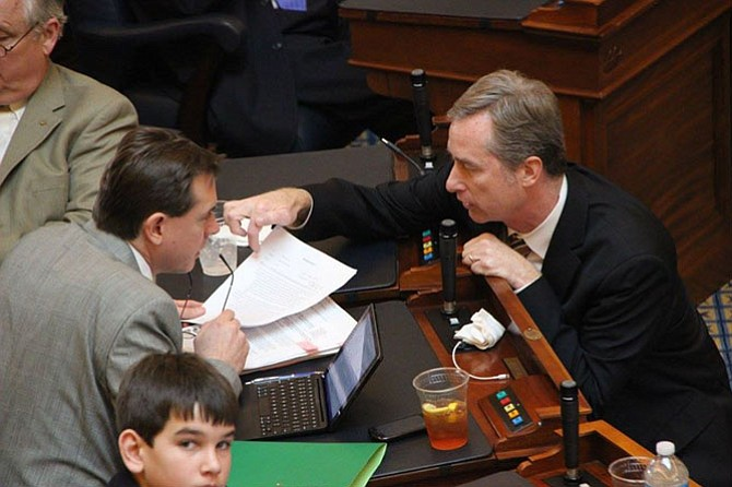 Del. David Bulova (D-37) works with Del. Jay Leftwich (R-78) on the floor of the Virginia General Assembly House of Delegates.