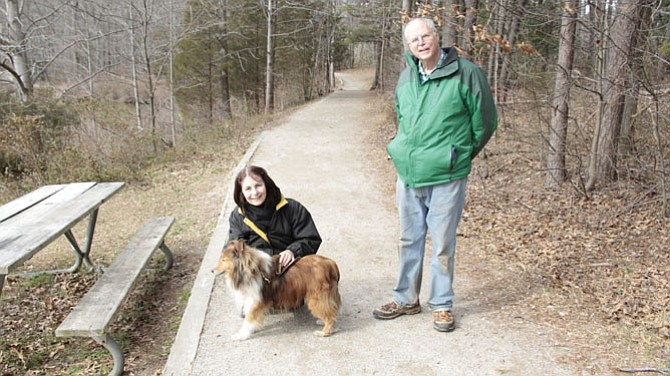 Robert Updegrove, retired library director, Fairfax, and his wife Maria enjoy their dog's companionship.