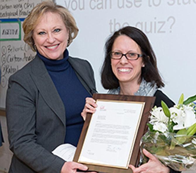 FCPS Superintendent Dr. Karen Garza awards Kilmer Middle School teacher Outstanding Teacher of the Year.