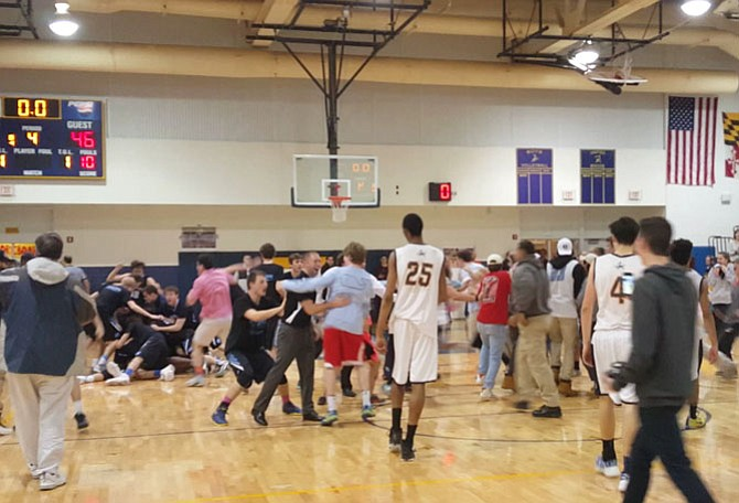 Whitman players and fans celebrate after the Vikings defeated B-CC on a buzzer-beating putback by Max Oppenheim in the 4A West section semifinals on Monday.