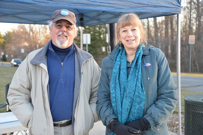 "Democratic Precinct Capt. Richard Chew and voter Nancy Olds braved the early morning chill on Super Tuesday at the South Lakes High School polling place in Reston. ""This is a heavily Democratic precinct,"" said Chew, ""but I think there has been a higher percentage of Republican turnout this year. People are really engaged."""