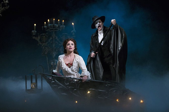 "Mary Michael Patterson as Christine Daae and Hugh Panaro as The Phantom in ""Phantom of the Opera."""