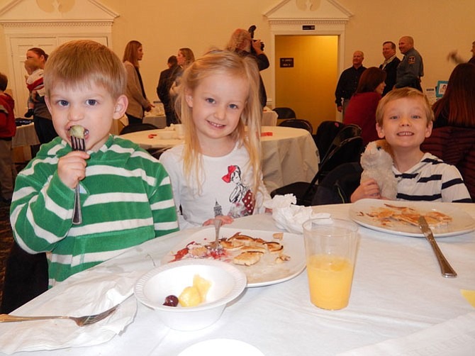 The Prentice siblings (from left) Luke, 2, Emma, 4, and Connor, 6, have fun at the breakfast.
