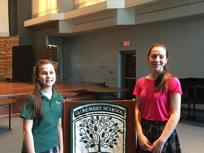Maria Luisa Bertolini, left, and Angela Diaz-Bonilla receive $5,000 scholarship as recipients of the Oakcrest School's Veritas Awards.