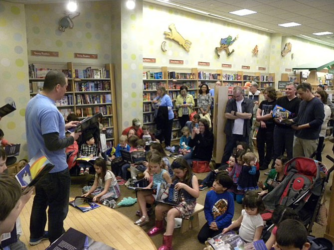 Scott McBride faces an audience of children, friends and family, as he reads from his book in front of a hometown audience at Barnes and Noble in Tysons Corner on Saturday, March 12.