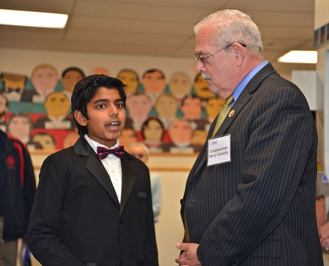"Aaron Joy, a fifth-grader at the Nysmith School, explains his science fair project on bio-plastics to U.S. Congressman Gerry Connolly (D-11), who was also an event speaker. During his remarks, Connolly praised Fairfax County in particular for its investment in education, but cautioned that ""other countries have caught up to us, we need to continue and advance our investment in STEM, in research and development and in improving our infrastructure."""