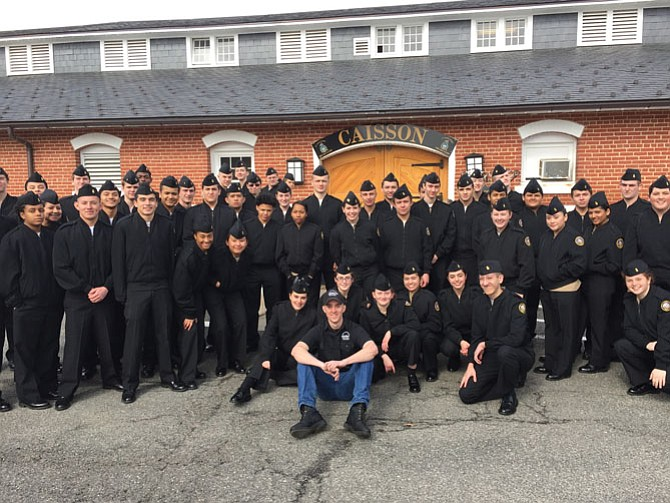 Cadets pose in front of The Old Guard Stables where caissons used to carry presidents and soldiers to their final resting place.