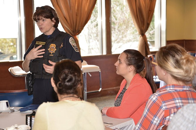 "Herndon Police Chief Maggie DeBoard talks with residents at the ""Coffee with a Cop"" event. DeBoard was appointed to a Steering Committee to help clear up a backlog of untested forensic kits from victims of sexual assault throughout the Commonwealth."