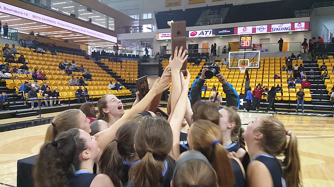 Members of the Whitman girls' basketball team celebrate winning the state championship. The Vikings defeated Western 71-55 in the 4A final on March 12.
