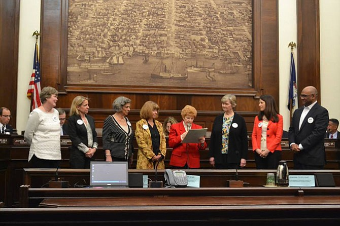 """From left: Carter Flemming, Jane Marcus, Dolores Viehman, MaryAnne Beatty, Councilwoman Del Pepper, Mary Lee Anderson, Donna Shaw and Todd Turner at the reading of the """"March for Meals"""" proclamation."""
