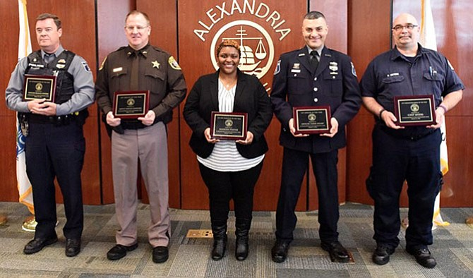 Five Crisis Intervention Team members were honored March 15: Officer Frank Powers, Deputy Darold Crawford, Public Safety Communications Officer Kanesha Foster, Officer Tarek Helmy, and Paramedic Chip Myers.