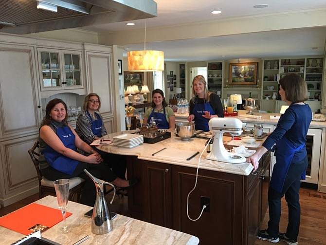 Terri Carr teaches a class in her Potomac kitchen.