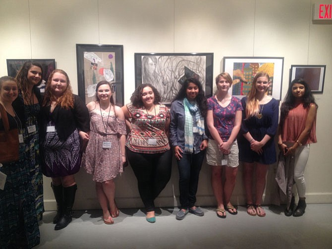 Herndon High School students pose for a picture during the March 16 evening reception at the 6th Annual Mind Heart Vision Exhibit. The exhibit closes on March 27.