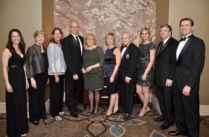 Senior Services of Alexandria Board Chair Donna Shaw, left, with SSA Executive Director Mary Lee Anderson, Mayor Allison Silberberg, Mike Porterfield, Kitty Porterfield, Sue Goodhart, H. Arthur Sauer; Allison Goodhart DuShuttle, Mike Day and Dave Hawkins at the SSA Generation to Generation Gala March 12 at the Hilton Mark Center.