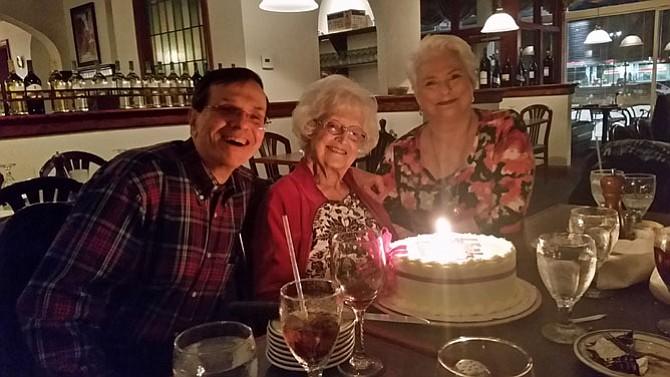 Melvin Russell of Arlington and Kristine Clark of Fairfax celebrate Eleanor Bune's (center) 98th birthday.