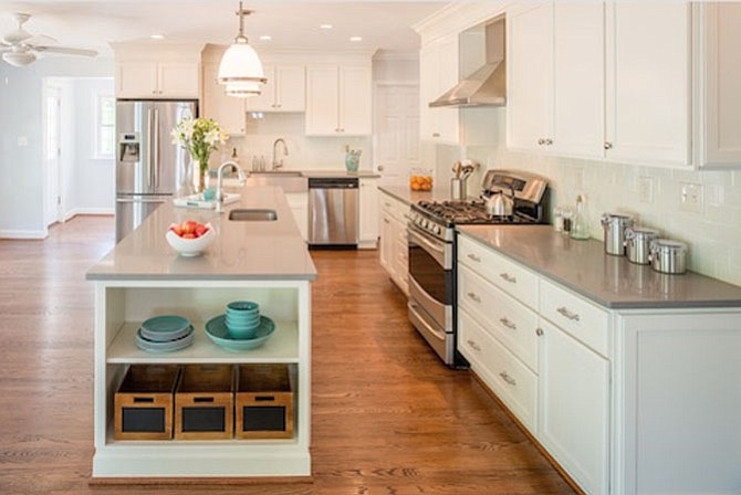 The kitchen of this newly remodeled Bethesda home includes a walk-in pantry, breakfast area, Caesarstone countertops and a Kohler vault apron front sink.