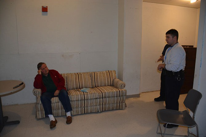 Officers (right) enter a fake residence to talk with a man role-playing as an emotionally disturbed person who was reported in the scenario to be suicidal.