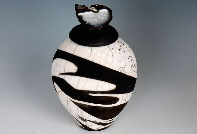 "Pictured here: ""Peace,"" Bev Andrews. The Associates Gallery will feature two member artists in a complementary scheme of black and white rendered in two-dimensional and three-dimensional work. Bev Andrews is a ceramic artist known for black and white raku vessels. The black color results from carbon produced in the firing process and the white is the natural color of the fired clay. Jo Ann Tooley is a fine art photographer who specializes in the black and white film. Work for this show includes prints made from old 35mm negatives depicting early morning scenes from rural  West Virginia, clouded by fog. ""It's Black and White"" will be on display March 29-April 24. Visit www.torpedofactory.org for more."