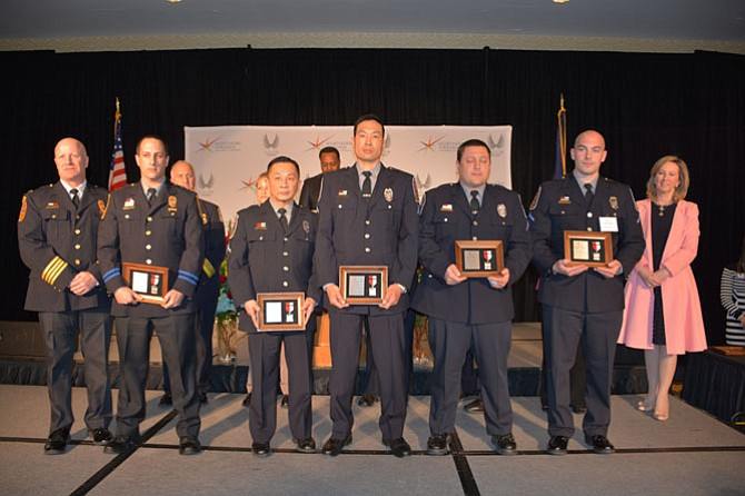 From left, Chief of Fairfax County Police Edwin Roessler Jr. presents Second Lieutenant Nicholas Depippa, Police Officer First Class Federick R. Yap, Police Officer First Class Peter T. Liu, Police Officer First Class Paul J. Blasko Jr. and Officer Jesse B. Katzman with the Silver Medal of Valor for responding to a shooting in the middle of the night and saving the victim's life.