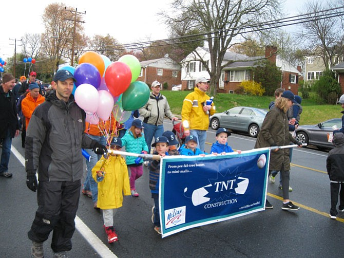 The little league team sponsored by TNT Construction heads down the parade route.
