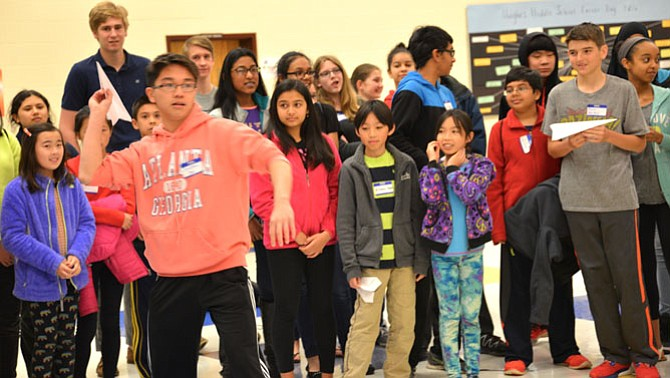 Jonathan Kan, an eighth-grader from Rocky Run Middle School in Chantilly, represents Team Big Pumpkin in the Paper Airplane Build and Fly Competition – and they won.