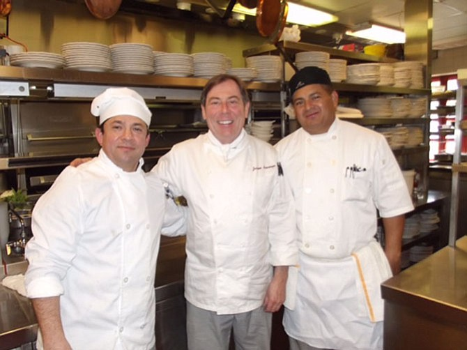 From left -- Sous chefs Freddie Ventura and Antonio Rivera in the kitchen with chef Jacques Haeringer.