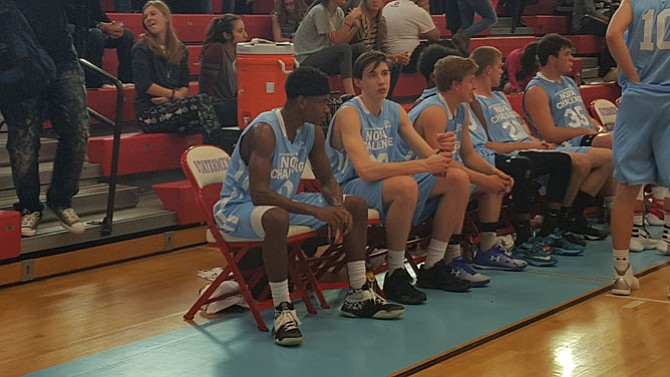 Westfield's Blake Francis, left, and Centreville's William Unterkofler, second from left, sit on the bench during the Nova Classic on April 10 at Marshall High School.