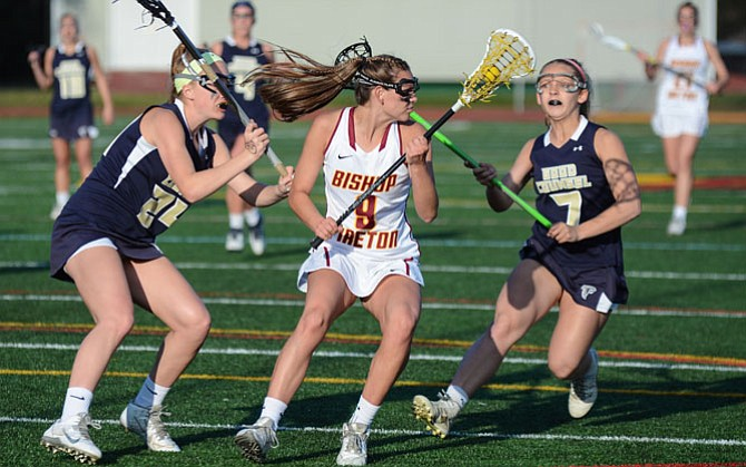 Kelly Larkin and the Bishop Ireton girls' lacrosse team recently suffered their first losses of the season, falling to Good Counsel (pictured) on April 8 and McDonogh on April 11.