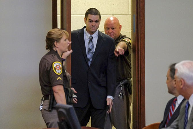 FAIRFAX, VA  Ð APRIL 18:.Fairfax police officer Adam Torres enters the courtroom before pleading guilty in the shooting death of citizen John B. Geer at Fairfax Circuit Court with Judge Robert J. Smith in Courtroom 5J on Monday, April 18, 2016, in Fairfax, VA.  Torres shot Geer as Geer was standing, unarmed with his hands up, in the doorway of his home..(Photo by Jahi Chikwendiu/The Washington Post)