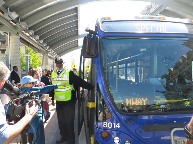 Transitway bus, driven by Akil Nuriddin, takes on its first passengers.