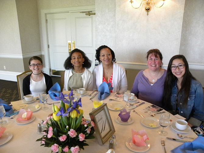 From left, Guests of DKG member Lamepa Bronell (middle) -- Emily Brown, 11, of Springfield; Olena Bronell, 12, of Annandale, Laura Reed, of Gainesville; and Alexis Wong, 14, of Gainesville -- attend the Beta Delta Chapter of DKG luncheon at the Springfield Golf and Country Club on Sunday, April 17.