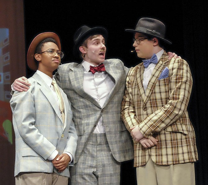 """From left are Erin Hugee, Tyler Shores, and Samuel Zarek in Mt. Vernon High School's production of """"Guys and Dolls."""""""