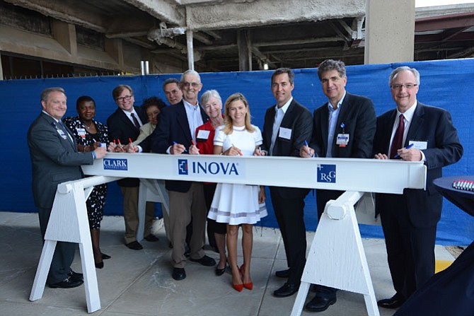 Guests and donors joined hospital employees and leaders on April 19 to sign the last steel beam to be added to the new Inova Mount Vernon Hospital Veatch Family Emergency Department.