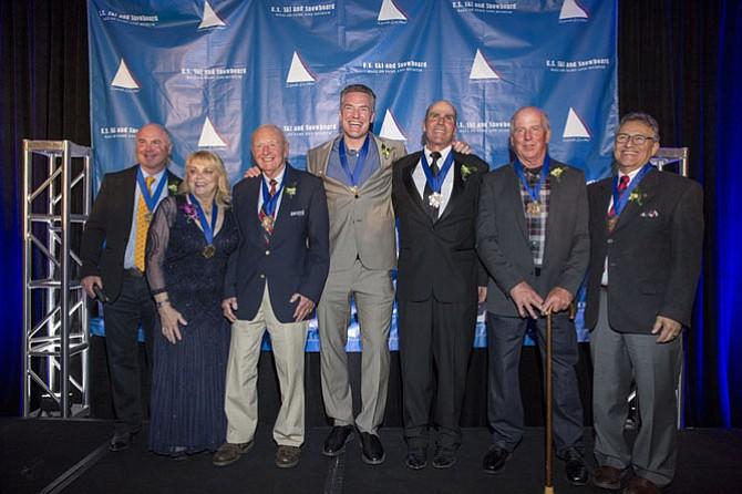 From left: Lessing Stern (representing Edgar Stern, deceased), Genia Fuller, Harry Kaiser, Chris Klug, Bob Salerno, Jim Martinson and David Ingemie