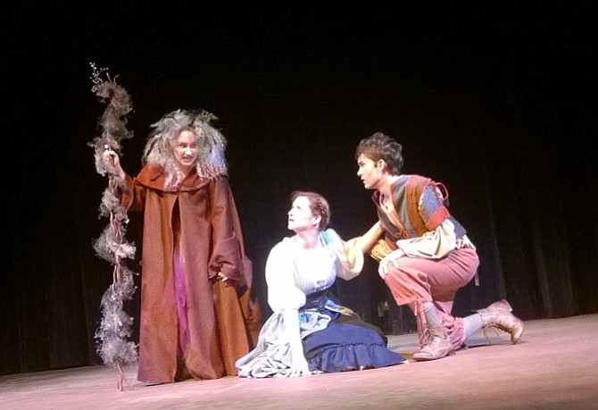 "From left:  The cast of ""Into the Woods"" is led by high school seniors Madyson Hanton as the Witch, Julia Mahon Kuzin as the Baker's Wife and Matthew Cook as the Baker."
