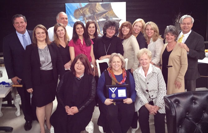 From left are Rick Hoffman, regional vice president; Rachel Carter, branch vice president; Tracy Vitali; Tom Rickert (back row); Kathy Kratovil; Ann Marie Grotticelli; Karen Leonard; Lyssa Seward; Beth Mazzanti; Cathy D'Antuono; Susie Carpenter; Ellis Duncan; (front row) Liz Bucuvalas; Bonnie Rivkin; and Donnan J. Wintermute.