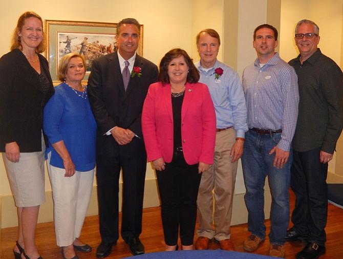 Mayor Scott Silverthorne (in suit) with City Council members (from left) Nancy Loftus, Janice Miller, Ellie Schmidt, David Meyer, Jon Stehle and Michael DeMarco.