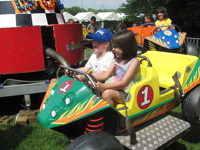 Caroline Ruddy, 5, at last year's McLean Day, and friend Ariana Palmieri, 6, last year, enjoy a trip in a flying car, Chitty Chitty Bang Bang style, at McLean Day 2015.