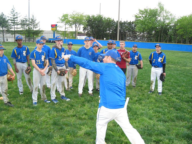 Lee High School baseball coach Matt MacDonald gives pointers to his team during practice.