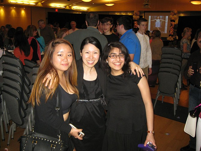 Fashion Design 1 students Jade Park and Kriti Bhagat with instructor Jin-A Chang (center) after the show.