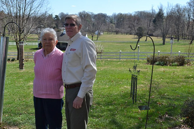 Jack Trunnell, CFO and co-owner of Trunnell Electric, stands with his mother Jean Trunnell in the yard of the family's Potomac home. The company is celebrating 80 years in business.
