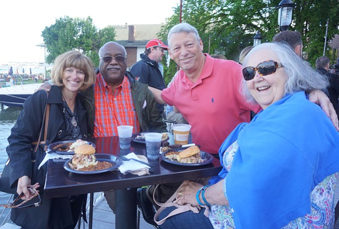 Maryanne Beatty, Lynnwood Campbell and Allan and Margie Lomax enjoy the ACT Community BBQ held May 16 along the waterfront.