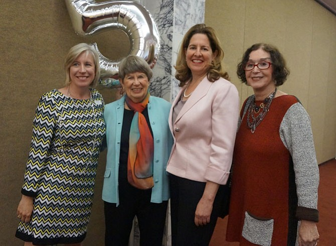 AHA executive director Cele Garrett, board member Barbara Rosenfeld, Mayor Allison Silberberg and author Judith Viorst celebrate the 5th anniversary of At Home in Alexandria May 17 at Beth El Hebrew Congregation.