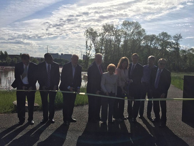 City Officials and citizens cut the ribbon for the new park