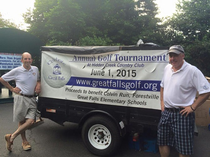 Tournament Chair Tim Burke (right) and  Mike Kearney holding up the sign last year.