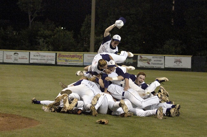 Members of the Chantilly baseball team leap onto a celebratory pile after winning the Conference 5 championship with a 4-2 victory over Centreville on Friday at Westfield High School.