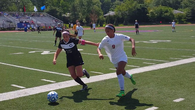 Claire Constant, right, and the T.C. Williams girls' soccer team defeated Chantilly in an 11-round PK shootout on Tuesday in the opening round of the 6A North region tournament.