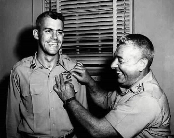 "In an undated photo, Capt. Humbert ""Rocky"" Versace receives his 90-day combat infantry badge from his father, Col. Humbert Joseph Versace. The Friends of Rocky Versace are coordinating the effort to track down photos of 13 Alexandria soldiers who were killed in Vietnam."