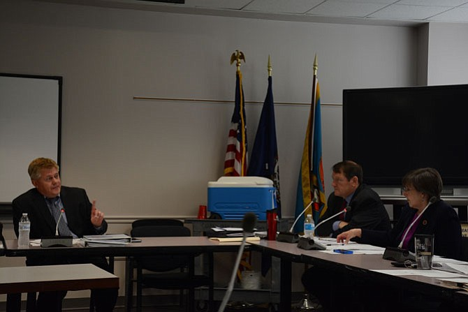 Supervisors (from left) John Cook (R-Braddock), Pat Herrity (R-Springfield) and Kathy Smith (D-Sully) discuss further police use of force and communications questions at the May 24 meeting of the Fairfax County Public Safety Committee meeting.